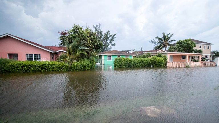 Houses line a flooded street after the effects of Hurricane Dorian arrived in Nassau, Bahamas, September 2, 2019. Pic: John Marc Nutt