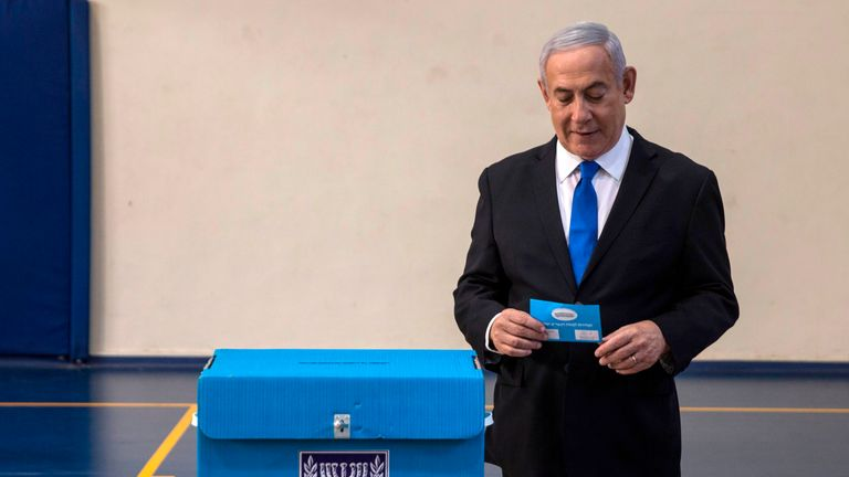 Israeli Prime Minister Benjamin Netanyahu casts his vote in Jerusalem