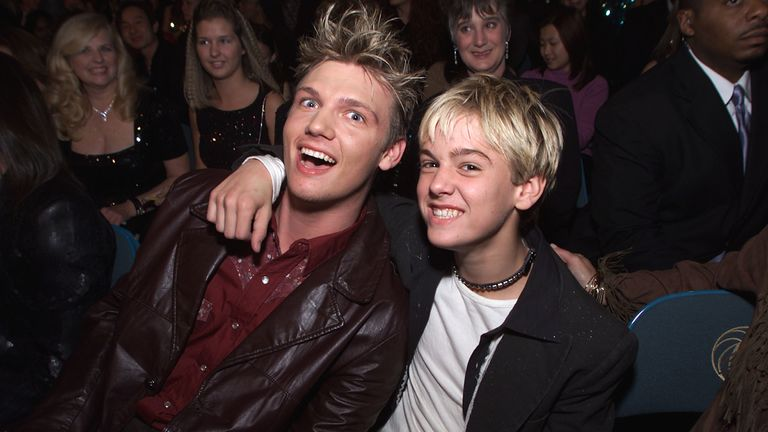 Nick Carter (Backstreet Boys) and his little brother Aaron Carter in the audience during the 2000 Billboard Music Awards in Las Vegas, Nevada. December 5, 2000