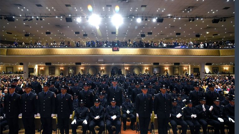 The ceremony included 21 people whose fathers had done the job before them. Pic: NYFD