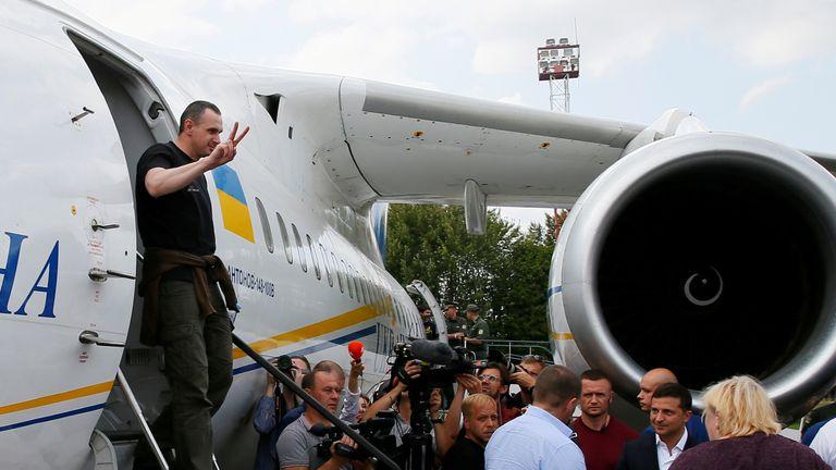 Ukrainian film director Oleg Sentsov, who was jailed on terrorism charges in Russia, gets off a plane upon arrival in Kiev after Russia-Ukraine prisoner swap, at Borispil International Airport, outside Kiev, Ukraine September 7, 2019