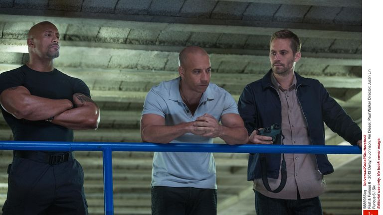 Paul Walker with Dwayne Johnson and Vin Diesel in Fast and Furious 6