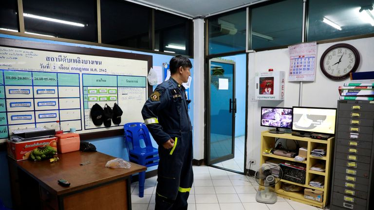 Firefighter Pinyo Pukpinyo, known as 'snake wrangler', watches TV at a fire station where he works, in Bangkok, Thailand, July 2, 2019