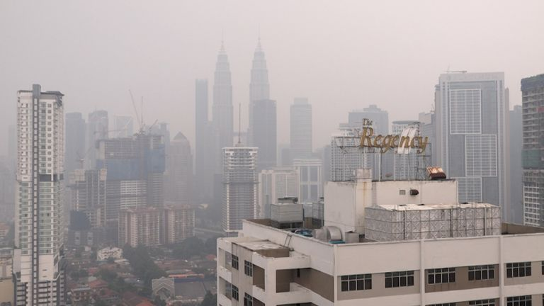 Images of the Kuala Lumpur city skyline. Pollution