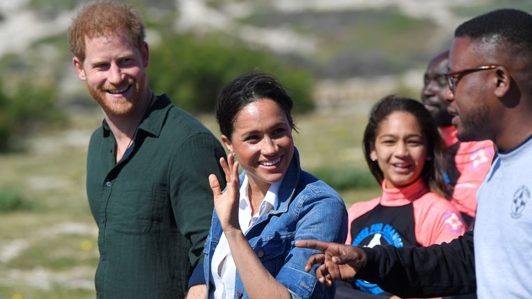 The Duke and Duchess of Sussex meet with members of the NGO Waves 4 Change, during their African tour, on Monwabisi Beach in Cape Town