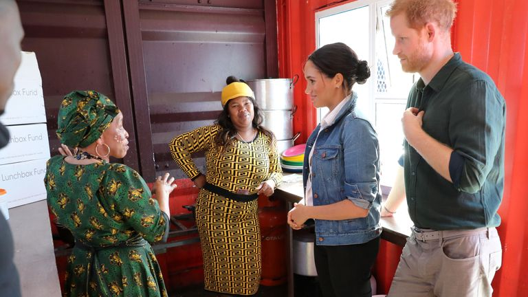 Meghan, Duchess of Sussex and Prince Harry, Duke of Sussex visit the Waves for Change compound kitchen, where charity The Lunchbox Fund, provides nearly 30,000 nutritious meals every day