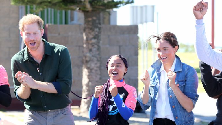 Prince Harry, Duke of Sussex and Meghan, Duchess of Sussex with surf mentors as they visit Waves for Change