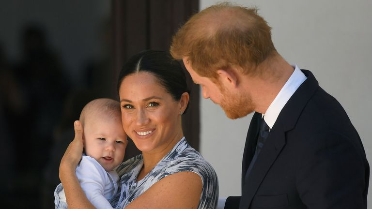 Prince Harry and Meghan, Duchess of Sussex, holding their son Archie, meet Archbishop Desmond Tutu