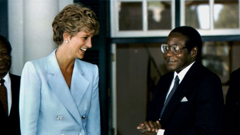 The Princess of Wales talks to President Robert Mugabe at Harare's State house in 1993