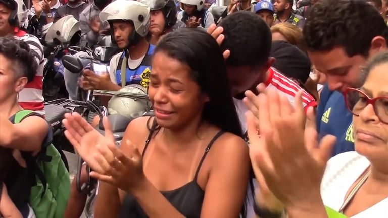 Hundreds of residents of one of Rio de Janeiro's largest shantytowns marched Saturday to demand an end to the violence after an 8-year-old girl was killed by a stray bullet during a police operation