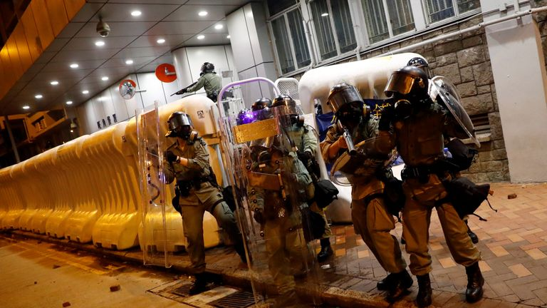 Riot police fired rubber bullets, tear gas and pepper spray to clear protesters