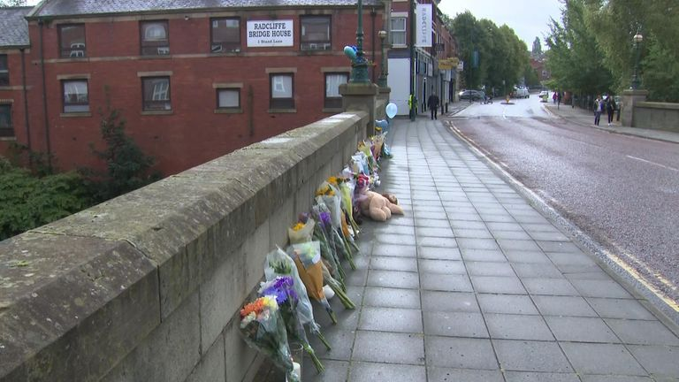 Flowers have been left at the River Irwell where the baby's body was pulled from