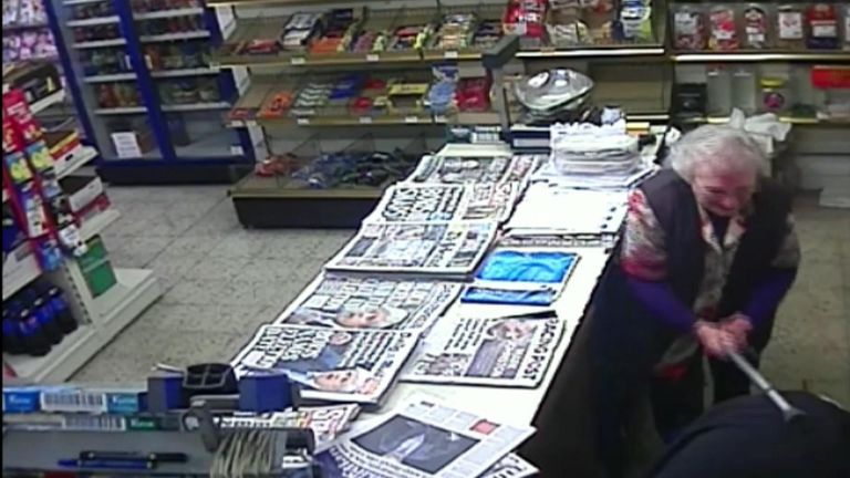 An 82-year-old woman fought off a man armed with a metal bar who robbed her shop. Anyone with information should call 101