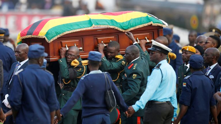 A casket carrying the remains of Robert Mugabe is taken to the military helicopter after viewing of his body at the Rufaro stadium, in Mbare, Harare