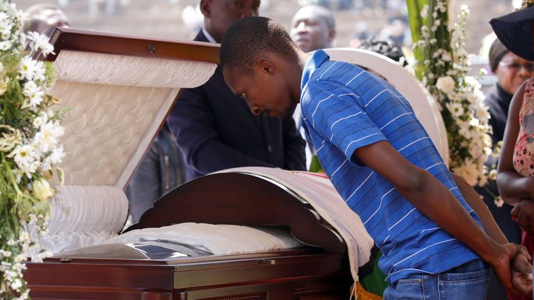 A mourner looks into the former president's coffin