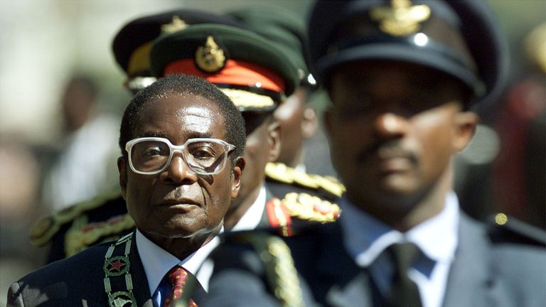 Robert Mugabe inspects troops at the opening of Parliament July 20, 2000