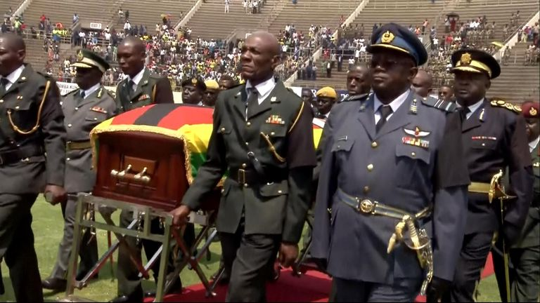 Robert Mugabe's coffin is paraded through the stadium