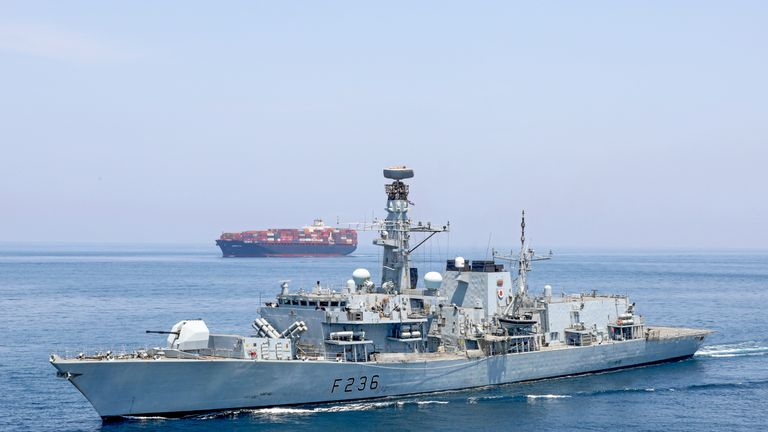 HMS Montrose accompanies a ship through the Strait of Hormuz. Pic: Royal Navy