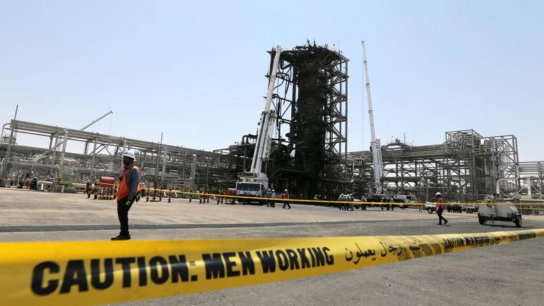 Workers at the damaged site of Saudi Aramco oil facility in Khurais, Saudi Arabia