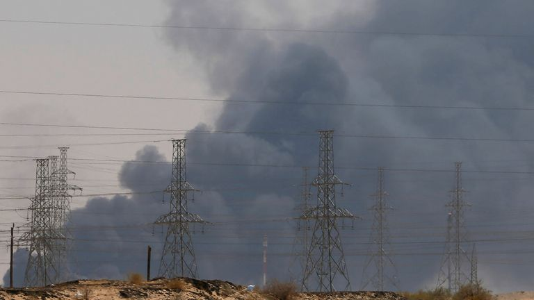 Smoke is seen following a fire at an Aramco factory in Abqaiq, Saudi Arabia