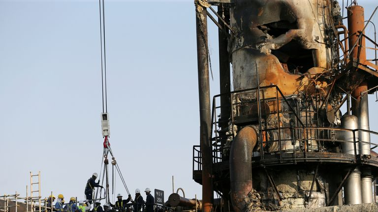 Workers at the damaged site of Saudi Aramco oil facility in Abqaiq