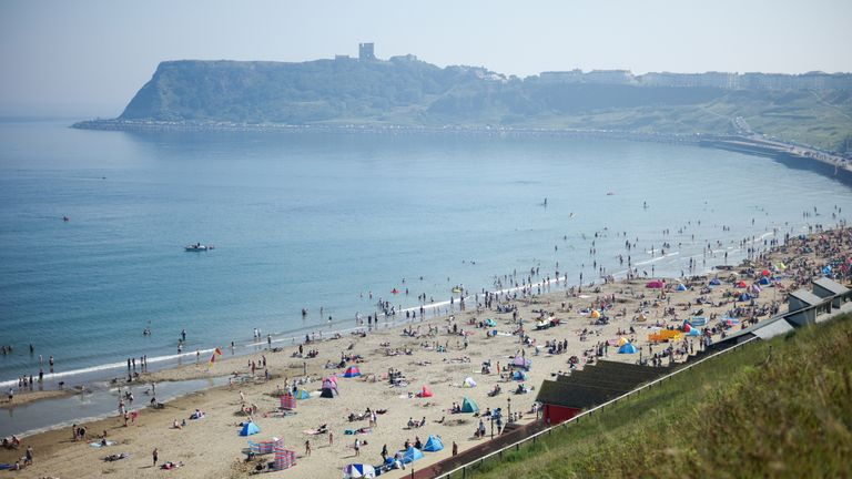 Thousands of people on the beach at Scarborough