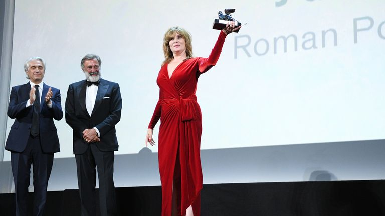 Emmanuelle Seigner receives the Silver Lion Award - Grand Jury Prize for An Officer And A Spy on behalf of her husband Roman Polanski