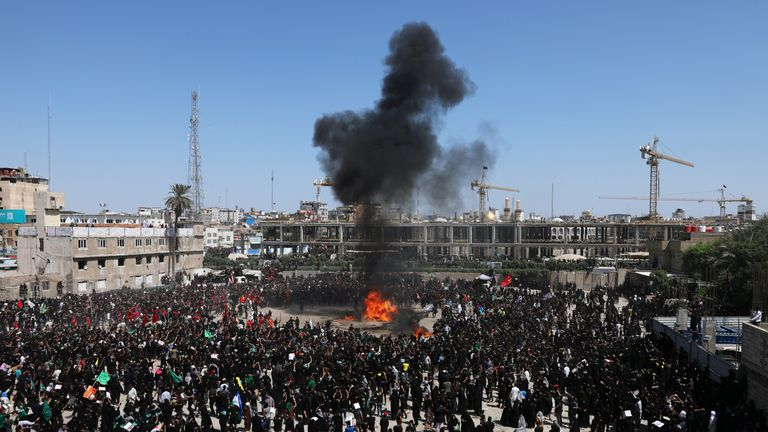 Shi'ite Muslims burn a tent to re-enact a scene from the battle of Kerbala in the holy city of Kerbala, Iraq