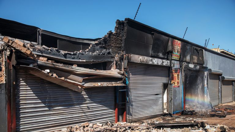 A partially destroyed shop is seen in the Johannesburg suburb of Malvern
