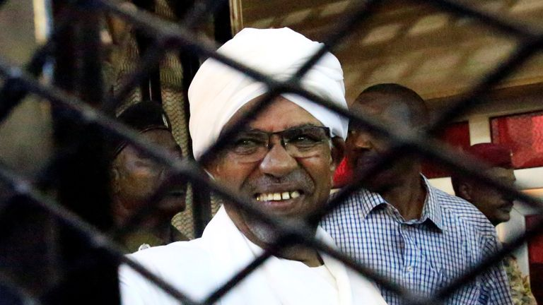 Sudan's former president Omar al Bashir inside a cage at the courthouse in Khartoum