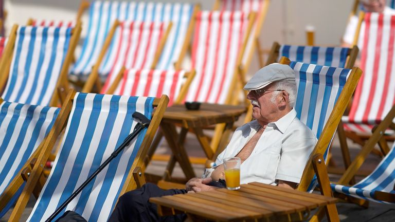 A man relaxes in a deck chair in the sun on the North Pier on the promenade on July 27, 2018 in Blackpool, England