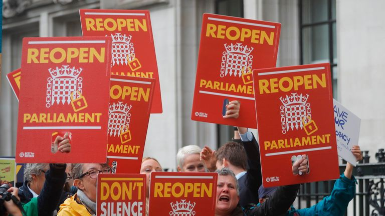 Protesters calling for parliament to be recalled shout outside the Supreme court in central London on September 24