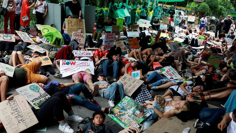 Climate change protesters in Thailand host a die-in after storming Bankok's environment ministry
