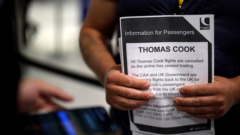 An information leaflet at the closed Thomas Cook check-in desk at the South Terminal of Gatwick Airport