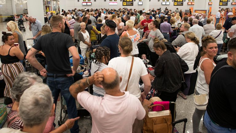 Thomas Cook passengers queueing at Son Sant Joan airport in Majorca
