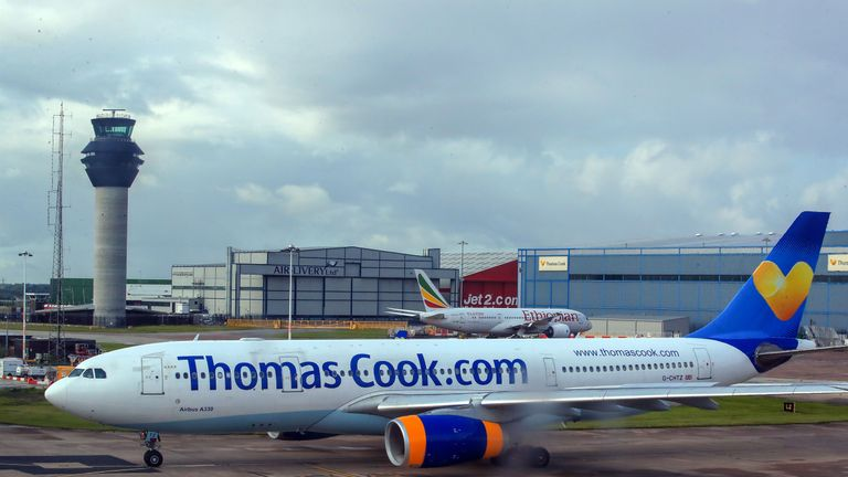 Thomas Cook and Ethiopian Airlines planes on the runway at terminal one Manchester Airport
