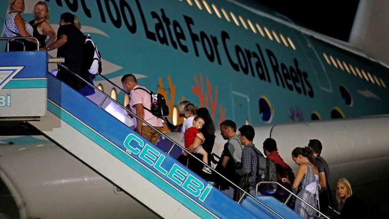 British passengers board an Airbus A380 airliner that is being used for transporting Thomas Cook customers at Dalaman Airport in Turkey
