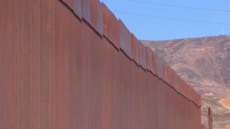 The wall is 30ft high and made of steel and concrete