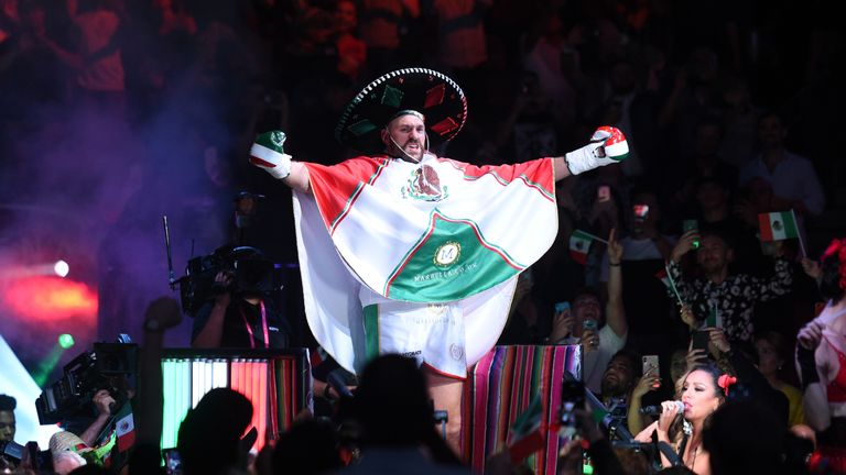 Tyson Fury makes his entrance to the ring for his heavyweight fight against Otto Wallin
