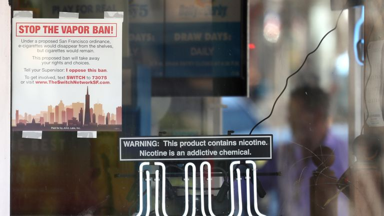 A neon sign advertising Juul e-cigarettes is displayed in a window of a tobacco store on June 25, 2019 in San Francisco, California. The San Francisco Board of Supervisors voted unanimously, 11-0, to be the first city in the United States to ban e-cigarettes, nicotine pods and devices that have not been approved by the Food and Drug Administration