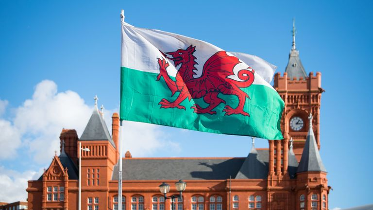 A Wales flag flies in front of the Pierhead Building in Cardiff Bay