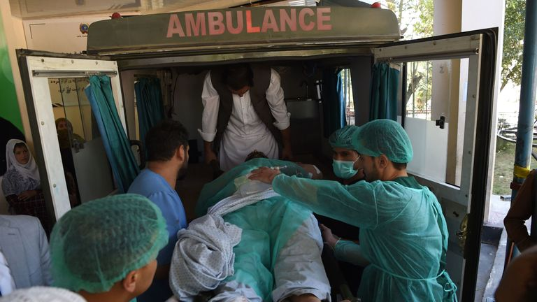 A wounded Afghan man is transported in an ambulance at the Wazir Akbar Khan hospital following a blast in Kabul on September 17, 2019. - A suicide bomber killed at least 24 people outside a campaign rally for Afghan President Ashraf Ghani on September 17, less than two weeks ahead of elections which the Taliban have vowed to disrupt