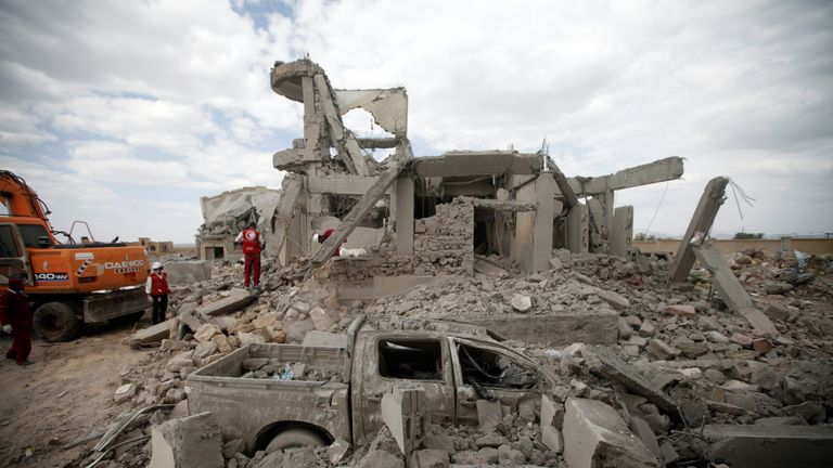 Red Crescent staff inspect the site of Saudi-led air strikes on a Houthi detention centre in Dhamar