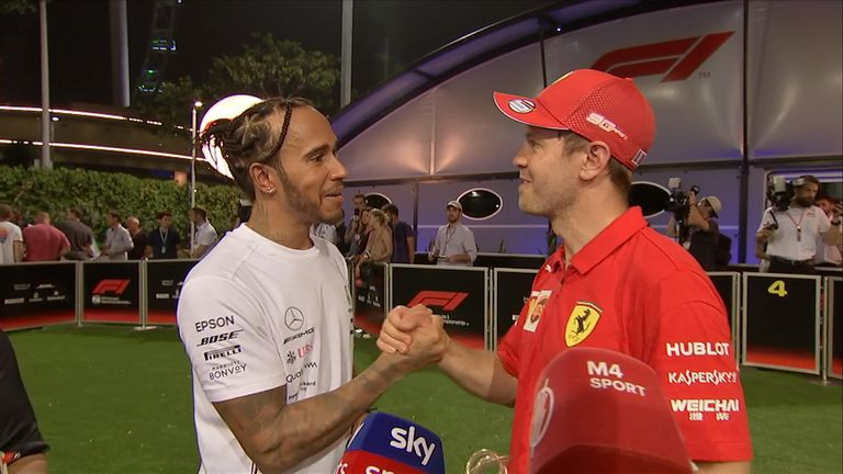 Sebastian Vettel's post-race interview was interrupted by rival Lewis Hamilton, who was keen to offer his congratulations