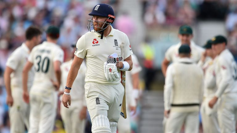 Jonny Bairstow walks back to the pavilion after losing his wicket for 22 runs on the first day of the fifth Ashes Test