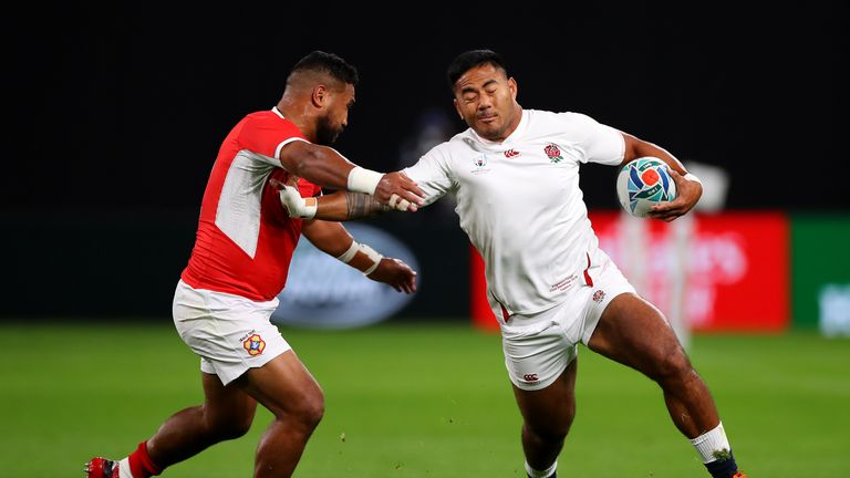 Manu Tuilagi looks to break forward for England against Tonga in their Rugby World Cup opener