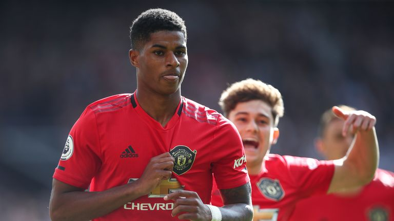 Marcus Rashford celebrates after making it 1-0 from the penalty spot