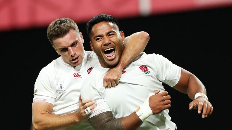 George Ford and Manu Tuilagi celebrate the latter's second try against Tonga