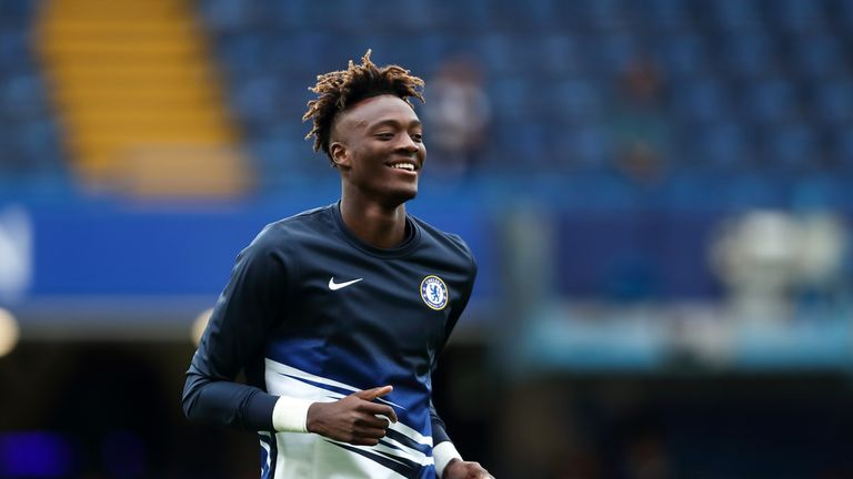 Tammy Abraham warms up prior to Chelsea's match vs Liverpool at Stamford Bridge