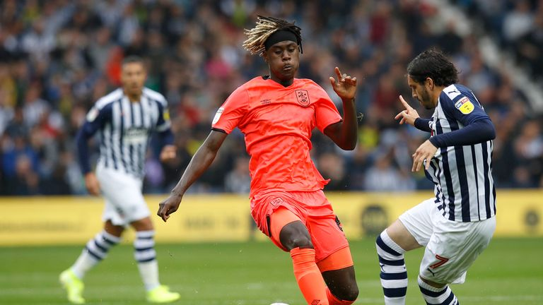 Huddersfield Town's Trevoh Chalobah battles for the ball with West Bromwich Albion's Filip Krovinovic